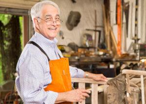 Senior man wood working