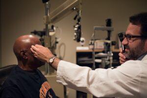 eye doctor giving patient an eye exam