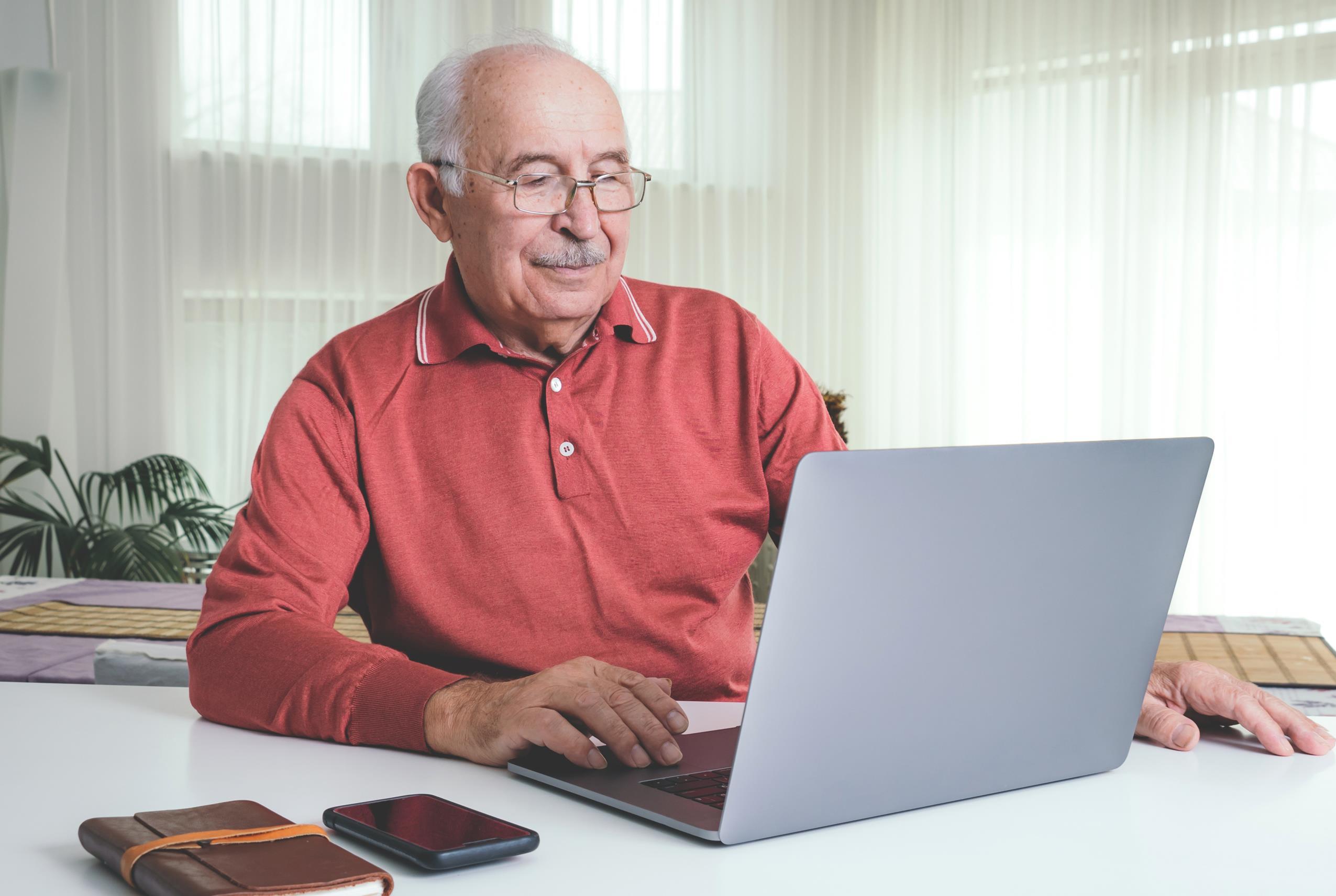 man using computer for telemedicine